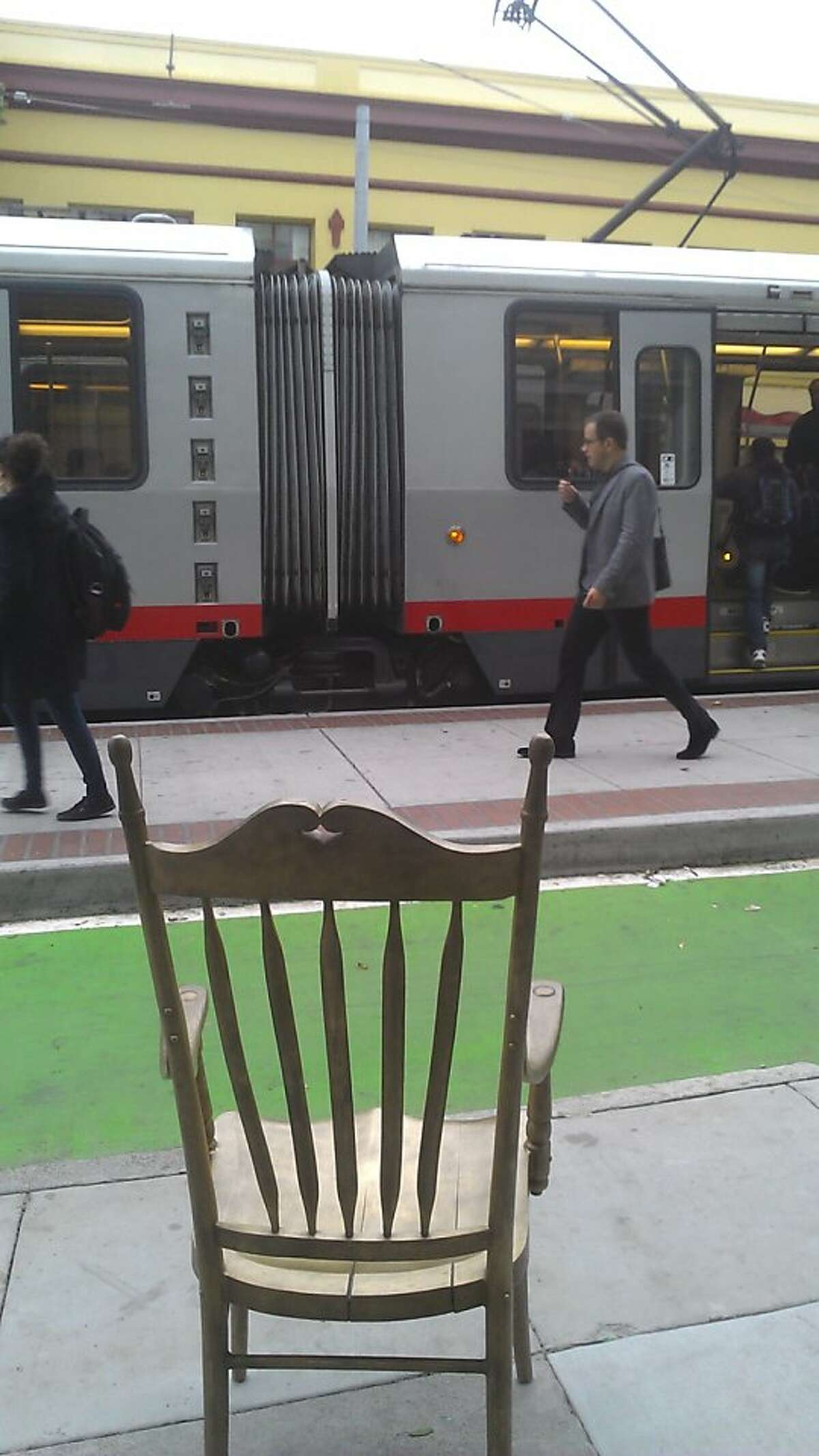 One of nine bronze chairs by artist Primitivo Suarez-Wolfe that the San Francisco Arts Commission has installed at Muni stops at Duboce and Church streets.