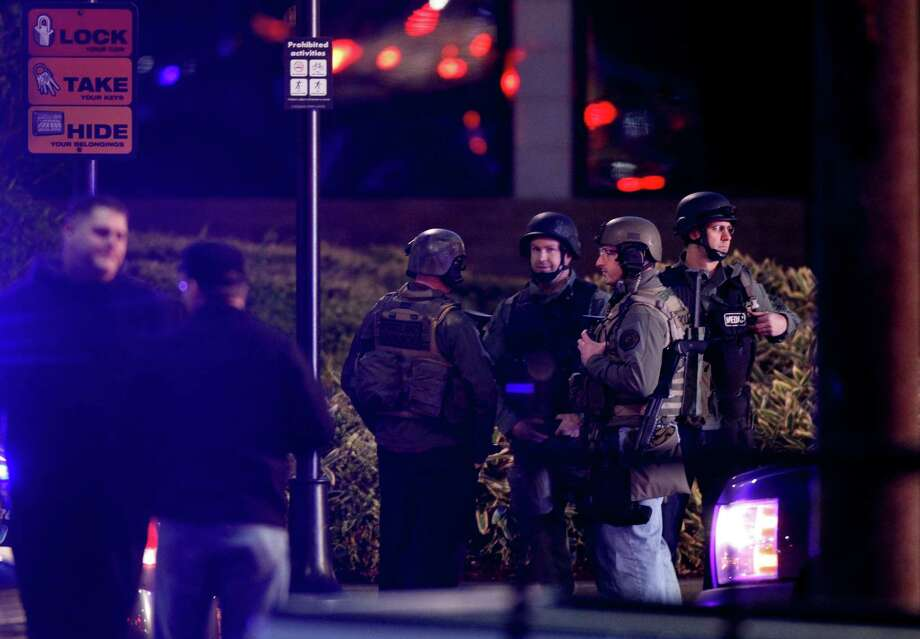 Law enforcement personnel work the scene of a shooting at the Clackamas Town Center in Clackamas, Ore. Tuesday, Dec. 11, 2012. A gunman opened fire in a Portland, Ore., area shopping mall Tuesday, killing at least one person and wounding an unknown number of others, sheriff's deputies said. Photo: Bruce Ely, Associated Press / The Oregonian