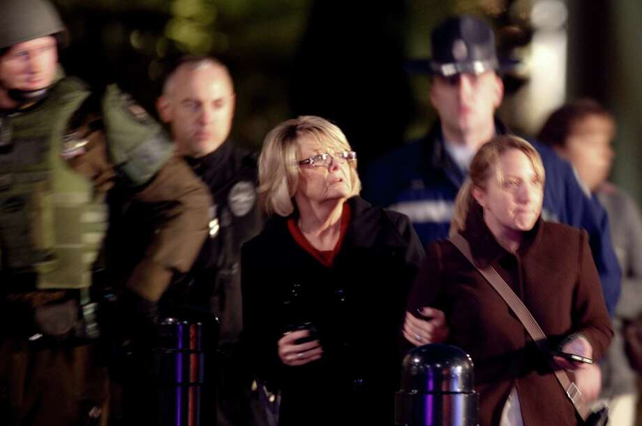 People look on outside Clackamas Town Center in Clackamas, Ore., where a shooting occured Tuesday, Dec. 11, 2012. A gunman opened fire in the Portland, Ore., area shopping mall Tuesday, killing at least one person and wounding an unknown number of others, sheriff's deputies said. Photo: Bruce Ely, Associated Press / The Oregonian