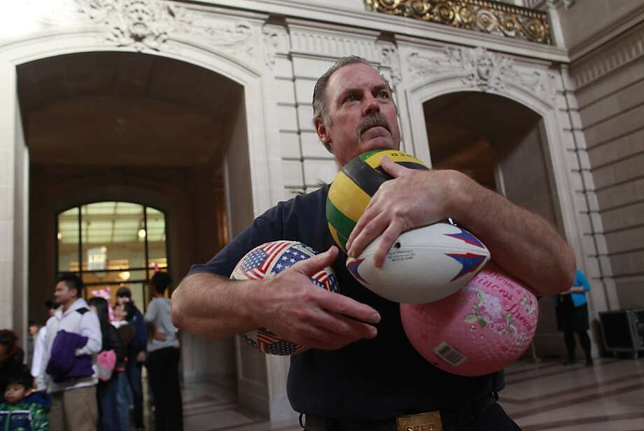San Francisco firefighter Phill Buckley prepares to load toy bags for needy children at City Hall on Tuesday Dec. 11, 2012 in San Francisco, Calif., where thanks to efforts of the San Francisco Firefighters Toy Program and the San Francisco Dept. of Child Support Services, join roughly 1200 kids who received toys. 