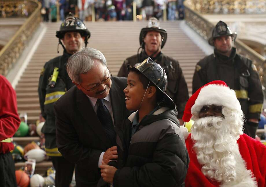 Mayor Ed Lee meets with Rodrigo Espinosa, 9, at City Hall on Tuesday Dec. 11, 2012 in San Francisco, Calif., where thanks to efforts of the San Francisco Firefighters Toy Program and the San Francisco Dept. of Child Support Services, join roughly 1200 kids who received toys. 