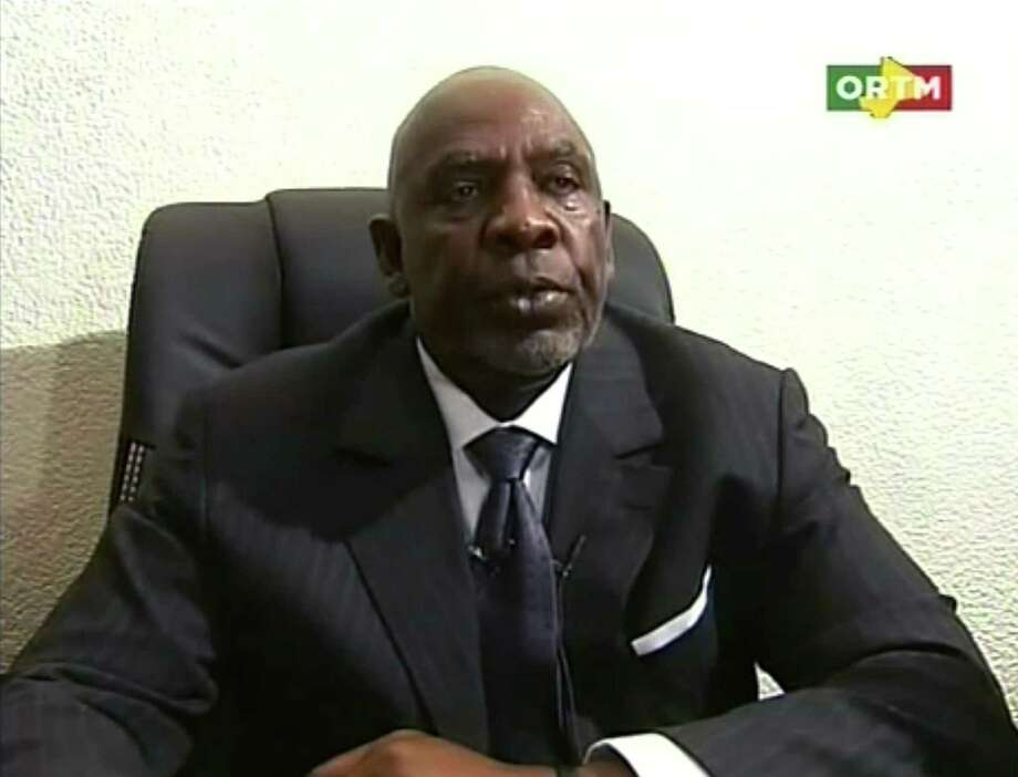 """An image grabbed on Malian official television ORTM shows Malian Prime Minister Cheick Modibo Diarra announcing his resignation in Bamako early on December 11, 2012.  Cheick Modibo Diarra resigned hours after influential former coup leader Captain Amadou Sanogo ordered soldiers to arrest him at his home. The ex-junta claims the move was not a coup, however Diarra's resignation plunges further into crisis a troubled nation which had over half its territory seized by Islamic extremists after Sanogo ousted its government in March. RESTRICTED TO EDITORIAL USE - MANDATORY CREDIT """"AFP PHOTO / ORTM"""" - NO MARKETING NO ADVERTISING CAMPAIGNS - DISTRIBUTED AS A SERVICE TO CLIENTSHO/AFP/Getty Images Photo: HO, Handout / AFP"""