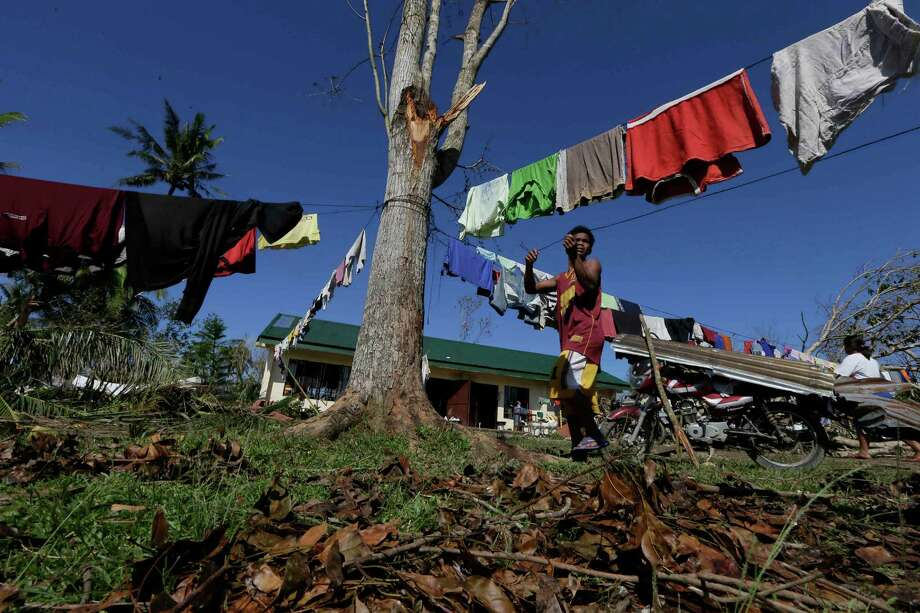 A typhoon evacuee prepares a clothesline at an evacuation center at Maparat township, Compostela Valley in southern Philippines Saturday Dec. 8, 2012. Search and rescue operations following typhoon Bopha that killed nearly 600 people in the southern Philippines have been hampered in part because many residents of this ravaged farming community are too stunned to assist recovery efforts, an official said Saturday. Photo: Bullit Marquez, Associated Press / AP