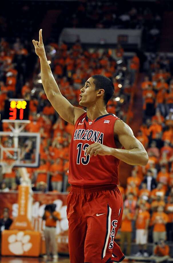 Nick Johnson and his Arizona teammates can improve the national reputation of the Pac-12 with a win over Florida. Photo: Rainier Ehrhardt, Associated Press