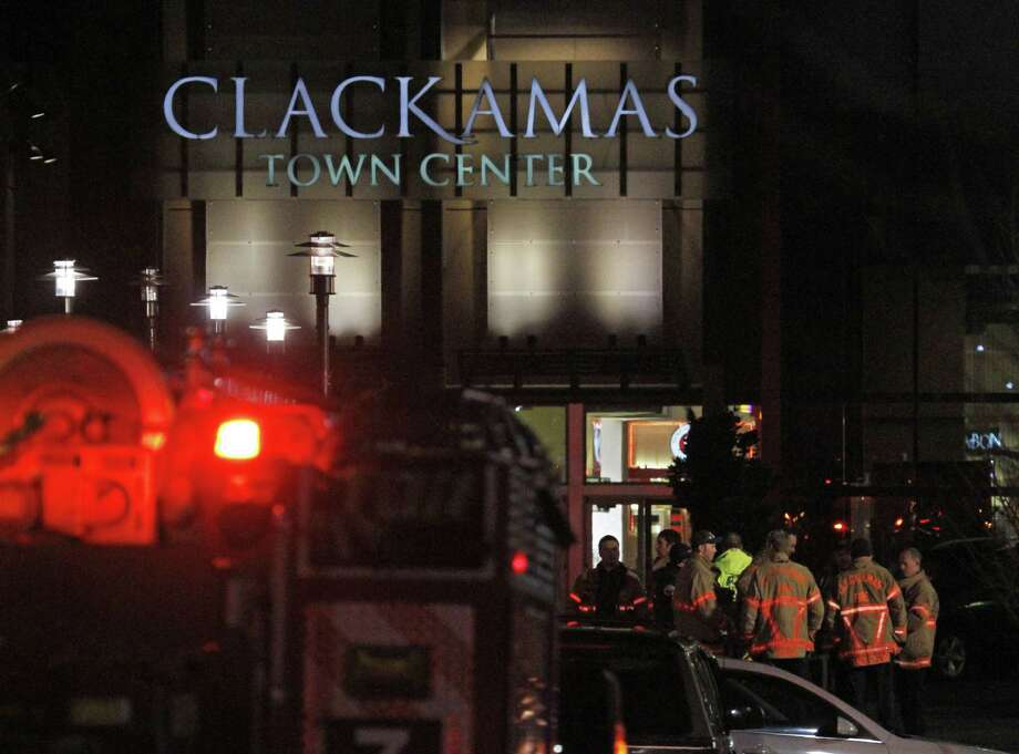 First responders stand outside where a gunman opened fire at the Clackamas Town Center shopping mall earlier in Portland, Ore., Tuesday, Dec. 11, 2012.  Police say three people are dead, including the gunman. Photo: Don Ryan, Associated Press / AP