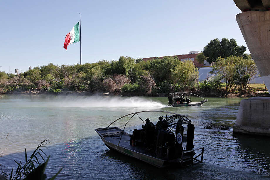 Boats carrying U.S. Border Patrol agents work the Rio Grande at Laredo. Their units supplement patrols by the U.S. Coast Guard, which is concentrating most of its efforts from Boca Chia to just north of McAllen. Photo: JERRY LARA / glara@express-news.net