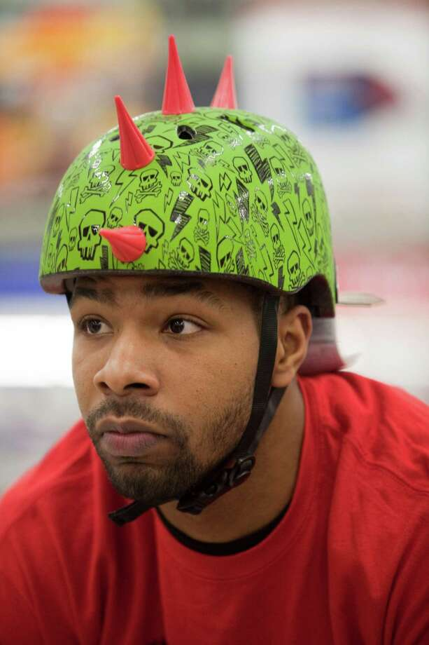 Houston Rockets player Marcus Morris wears a helmet Dec. 11, 2012 in Houston at Toys R Us. Photo: Eric Kayne / © 2012 Eric Kayne