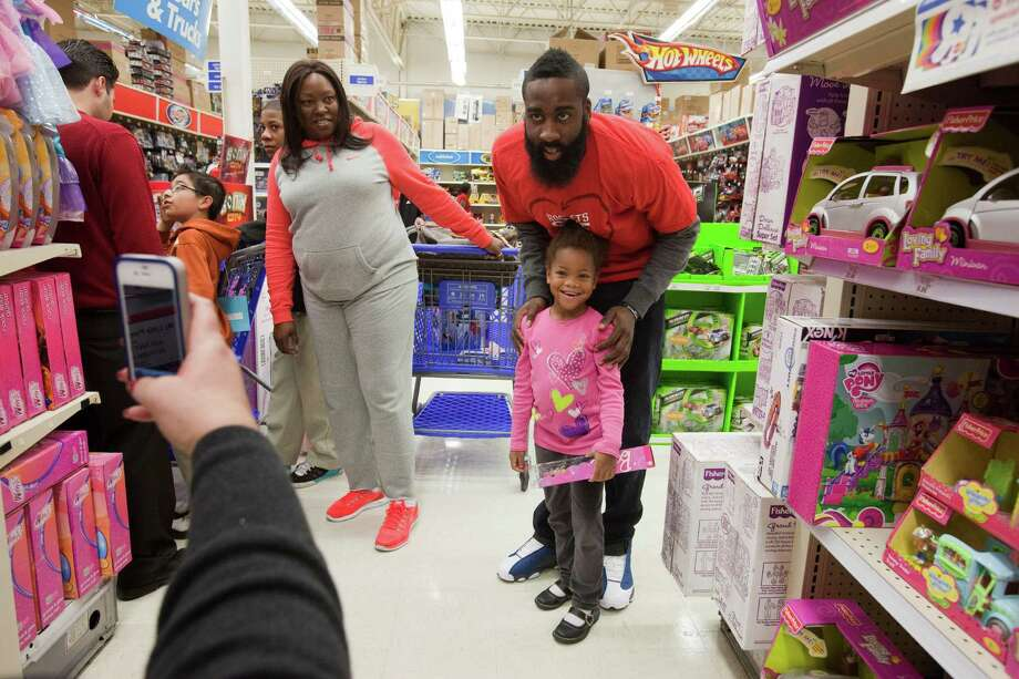 Katie Morgan, 5, has her photo taken with Houston Rocket James Hardin Dec. 11, 2012 in Houston at Toys R Us. Photo: Eric Kayne / © 2012 Eric Kayne
