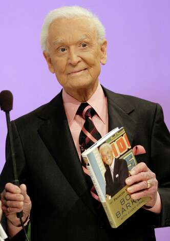"Television icon Bob Barker returns for one show to the The Price is Right game show at the CBS Studio Center in Los Angeles on Wednesday, March 25, 2009. Baker, the longtime host of the daily game show, who recently retired and passed the microphone off to Drew Carey, appeared Wednesday in order to promote his autobiography, ""Priceless Memories."" The episode will air on April 16. (AP Photo/Damian Dovarganes) Photo: Damian Dovarganes / AP"