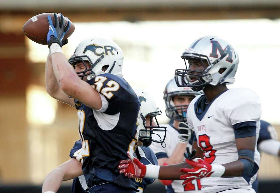 Casey Cotter's recovery of an onside kick was part of the dramatic finish in Cy Ranch's win over Manvel. Photo: Thomas B. Shea / © 2012 Thomas B. Shea