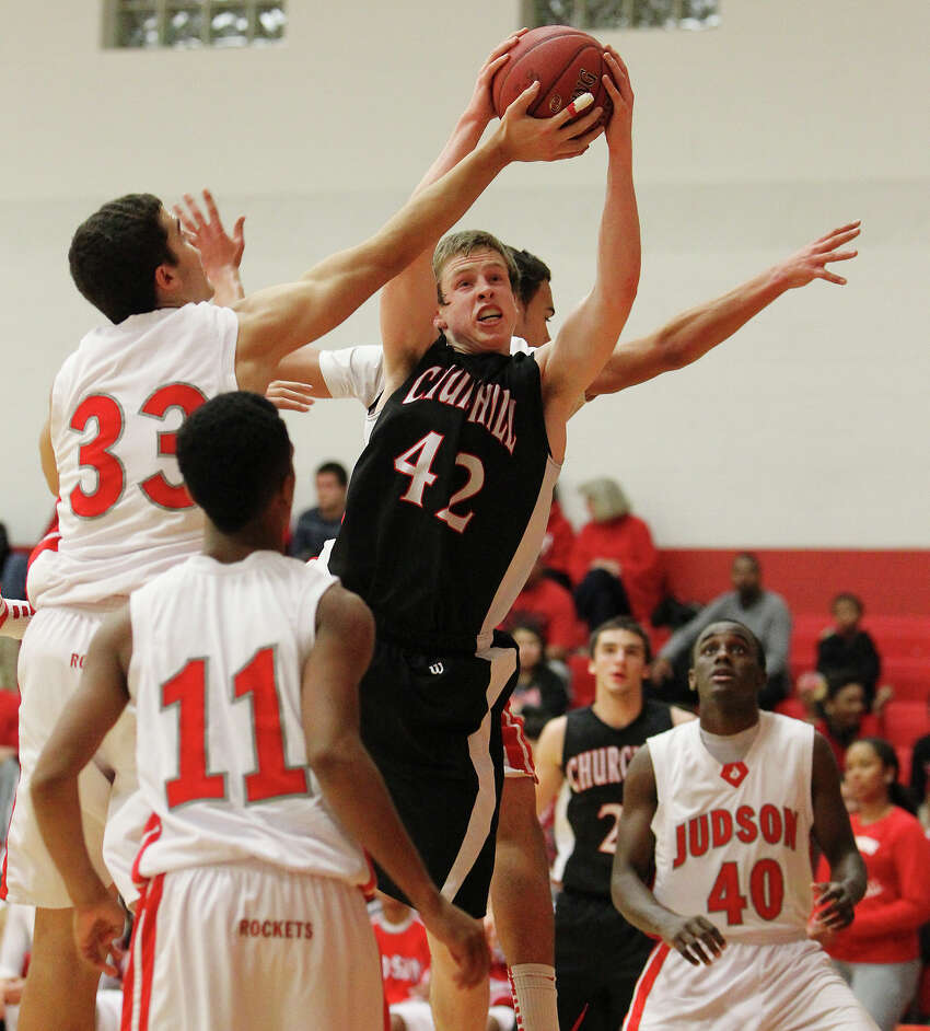 Churchill's Brian Herring (42) grabs a rebound against a gropu of Judson players including David Wacker (33) during their non-district game at Judson on Tuesday, Dec. 11, 2012. Churchill defeated Judson, 57-54.