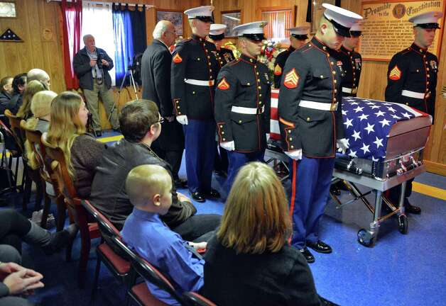 A Marine honor guard with the casket bearing Marine Corps Lance Cpl. Anthony Denier, a lifelong Mechanicville resident who was killed by enemy fire while on patrol Dec. 2. in Marjah, Afghanistan, during funeral services American Legion Lt. Fred Clark Post 91 in Mechanicville Tuesday Dec. 11, 2012.  (John Carl D'Annibale / Times Union) Photo: John Carl D'Annibale / 00020401A