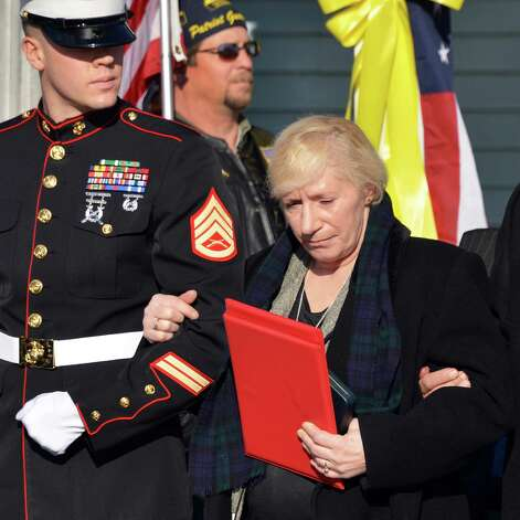 Mary Morgan, mother of Marine Corps Lance Cpl. Anthony Denier, a lifelong Mechanicville resident who was killed by enemy fire while on patrol Dec. 2. in Marjah, Afghanistan, with a Marine escort during funeral services American Legion Lt. Fred Clark Post 91 in Mechanicville Tuesday Dec. 11, 2012.  (John Carl D'Annibale / Times Union) Photo: John Carl D'Annibale / 00020401A
