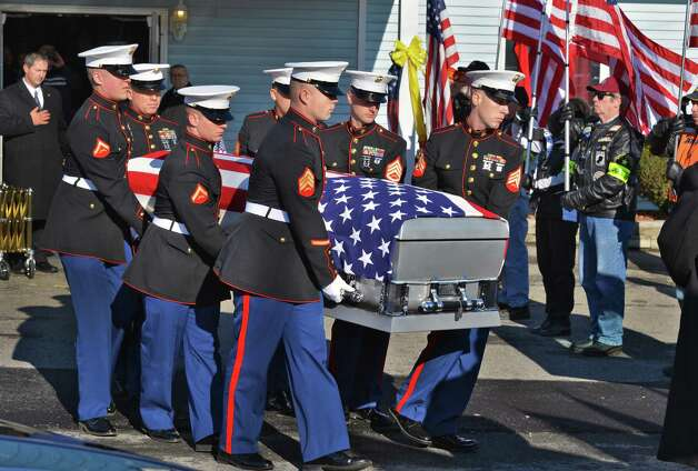 A Marine honor guard carries the casket bearing Marine Corps Lance Cpl. Anthony Denier, a lifelong Mechanicville resident who was killed by enemy fire while on patrol Dec. 2. in Marjah, Afghanistan, following funeral services American Legion Lt. Fred Clark Post 91 in Mechanicville Tuesday Dec. 11, 2012.  (John Carl D'Annibale / Times Union) Photo: John Carl D'Annibale / 00020401A
