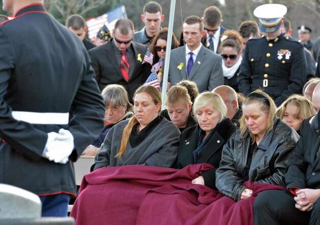 Mary Morgan,center, mother of Marine Corps Lance Cpl. Anthony Denier, a lifelong Mechanicville resident who was killed by enemy fire while on patrol Dec. 2. in Marjah, Afghanistan, sits with family members during ceremonies at the Gerald B. H. Solomon Saratoga  National Cemetery Tuesday Dec. 11, 2012.  (John Carl D'Annibale / Times Union) Photo: John Carl D'Annibale / 00020401A
