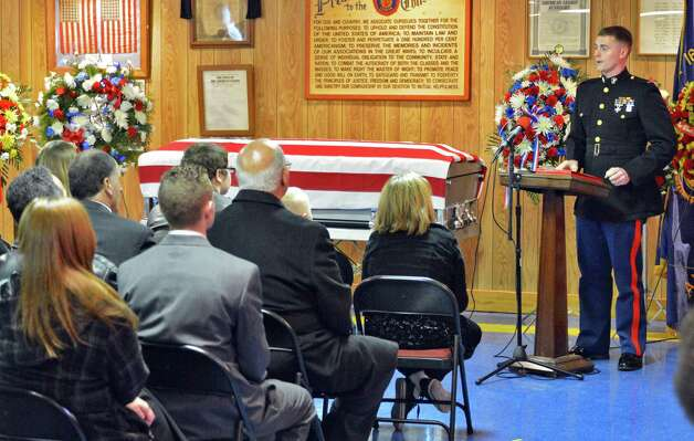USMC Lt. Richard Bondi, at right, speaks at the funeral of Marine Corps Lance Cpl. Anthony Denier, a lifelong Mechanicville resident who was killed by enemy fire while on patrol Dec. 2. in Marjah, Afghanistan, during services American Legion Lt. Fred Clark Post 91 in Mechanicville Tuesday Dec. 11, 2012.  (John Carl D'Annibale / Times Union) Photo: John Carl D'Annibale / 00020401A