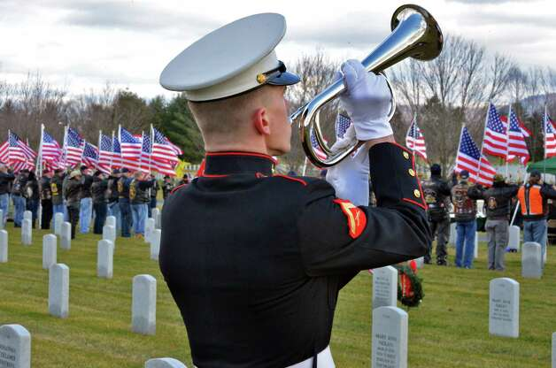 A Marine honor guard plays taps during ceremonies for Marine Corps Lance Cpl. Anthony Denier, a lifelong Mechanicville resident who was killed by enemy fire while on patrol Dec. 2. in Marjah, Afghanistan,at the Gerald B. H. Solomon Saratoga National Cemetery Tuesday Dec. 11, 2012.  (John Carl D'Annibale / Times Union) Photo: John Carl D'Annibale / 00020401A