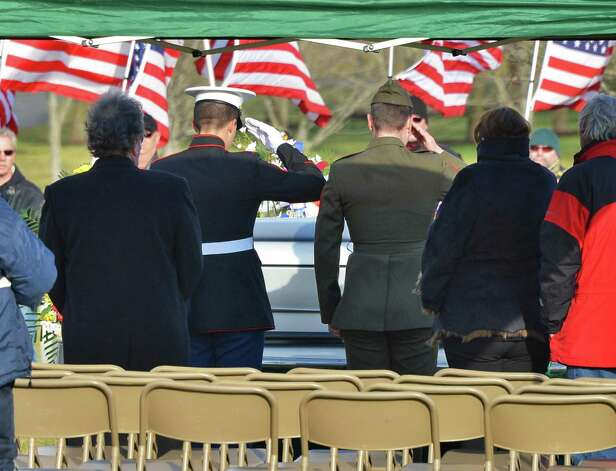 Two Marines give a final salute for Marine Corps Lance Cpl. Anthony Denier, a lifelong Mechanicville resident who was killed by enemy fire while on patrol Dec. 2. in Marjah, Afghanistan, at the Gerald B. H. Solomon Saratoga National Cemetery Tuesday Dec. 11, 2012.  (John Carl D'Annibale / Times Union) Photo: John Carl D'Annibale / 00020401A