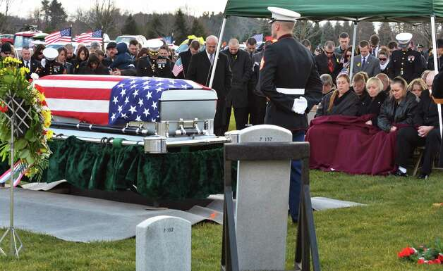 Family members, at right, during burial ceremonies for Marine Corps Lance Cpl. Anthony Denier, a lifelong Mechanicville resident who was killed by enemy fire while on patrol Dec. 2. in Marjah, Afghanistan, at the Gerald B. H. Solomon Saratoga National Cemetery Tuesday Dec. 11, 2012.  (John Carl D'Annibale / Times Union) Photo: John Carl D'Annibale / 00020401A