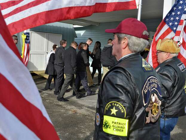 Patriot Guard Riders outside American Legion Lt. Fred Clark Post 91 in Mechanicville Tuesday Dec. 11, 2012, as mourners arrive for funeral services for Marine Corps Lance Cpl. Anthony Denier, a lifelong Mechanicville resident who was killed by enemy fire while on patrol Dec. 2. in Marjah, Afghanistan.   (John Carl D'Annibale / Times Union) Photo: John Carl D'Annibale / 00020401A