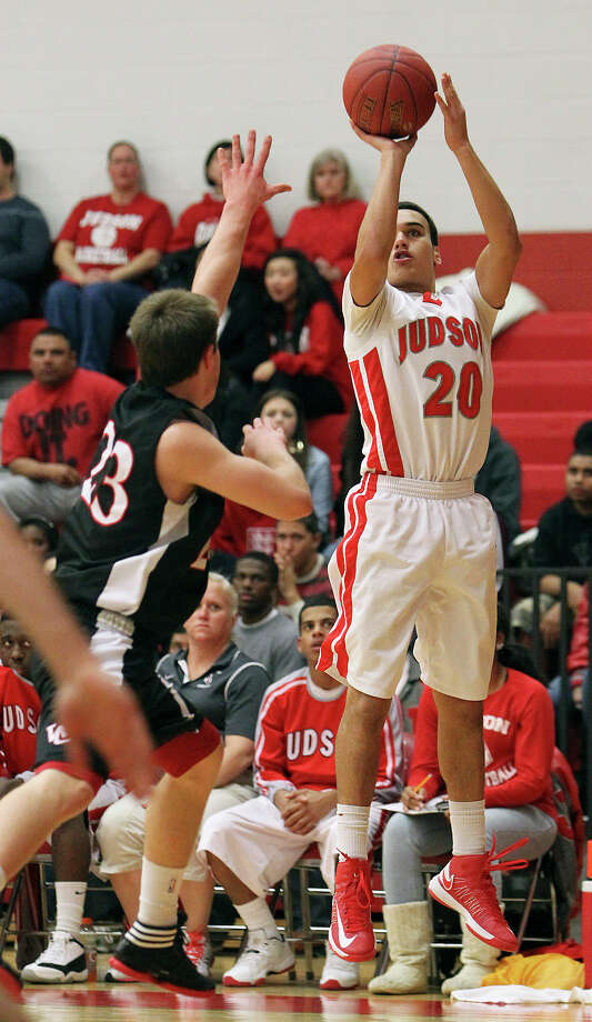 Judson's Tony Allen (20) lines up a jump shot against Churchill's Ben Mammel (23) during their non-district game at Judson on Tuesday, Dec. 11, 2012. Churchill defeated Judson, 57-54. Photo: Kin Man Hui, San Antonio Express-News / ©2012 San Antonio Express-News
