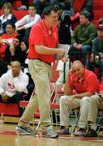 Judson coach Mike Wacker punches his binder during a non-district game against Churchill on Tuesday, Dec. 11, 2012. Churchill defeated Judson, 57-54. Photo: Kin Man Hui, San Antonio Express-News / ©2012 San Antonio Express-News