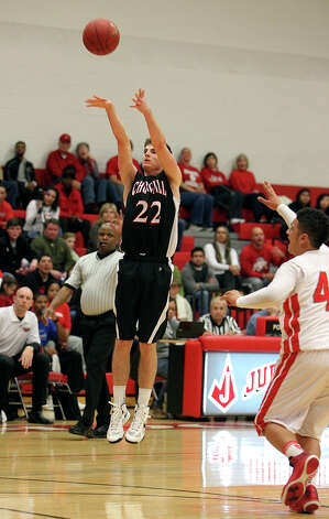 Churchill's Sam Burmeister (22) hoists up a three-pointer against Judson during their non-district game at Judson on Tuesday, Dec. 11, 2012. Churchill defeated Judson, 57-54. Photo: Kin Man Hui, San Antonio Express-News / ©2012 San Antonio Express-News