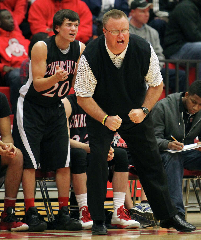 Churchill coach Timothy Woods pumps up his team during their game against Judson on Tuesday, Dec. 11, 2012. Churchill defeated Judson, 57-54.