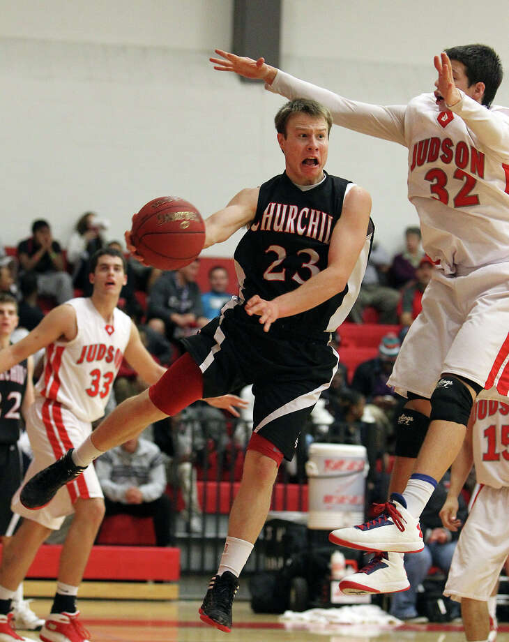 Churchill's Ben Mammel (23) looks to pass against Judson's Tanner Leissner (32) during their non-district game at Judson on Tuesday, Dec. 11, 2012. Churchill defeated Judson, 57-54. Photo: Kin Man Hui, San Antonio Express-News / ©2012 San Antonio Express-News