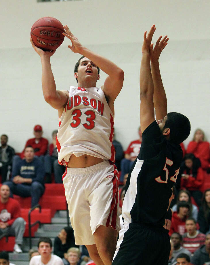 Judson's David Wacker (33) goes to the paint for a shot against Churchill's Abdulla Al-Bader (54) during their non-district game at Judson on Tuesday, Dec. 11, 2012. Churchill defeated Judson, 57-54. Photo: Kin Man Hui, San Antonio Express-News / ©2012 San Antonio Express-News