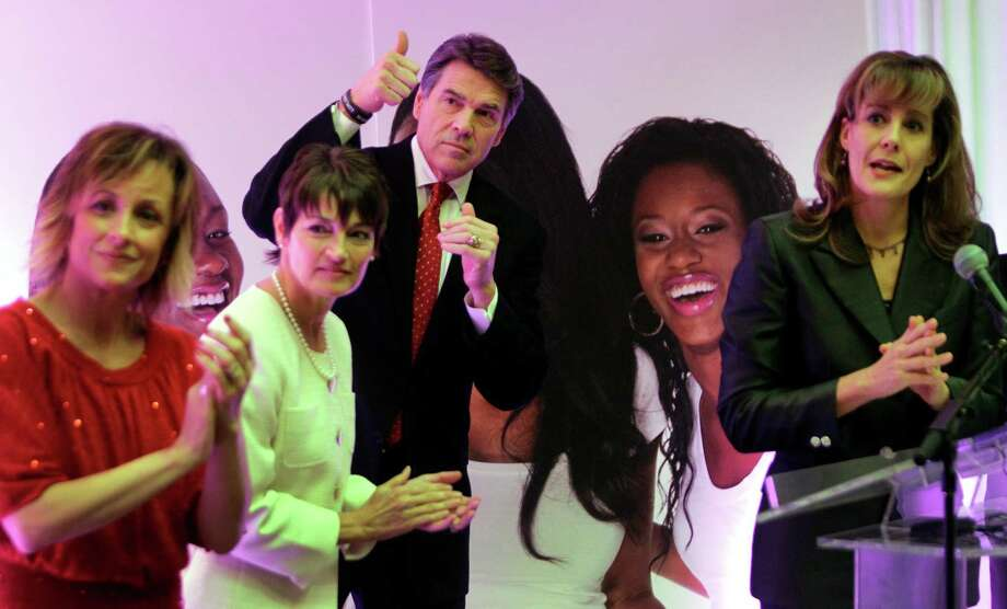 Cynthia Wenz, CEO of the Source for Women, left; Texas Senator-elect Dr. Donna Campbell; and Elizabeth Graham, Texas Right to Life director, right; join Gov. Rick Perry for his announcement that he would back new abortion legislation. Photo: Melissa Phillip, Staff / © 2012 Houston Chronicle