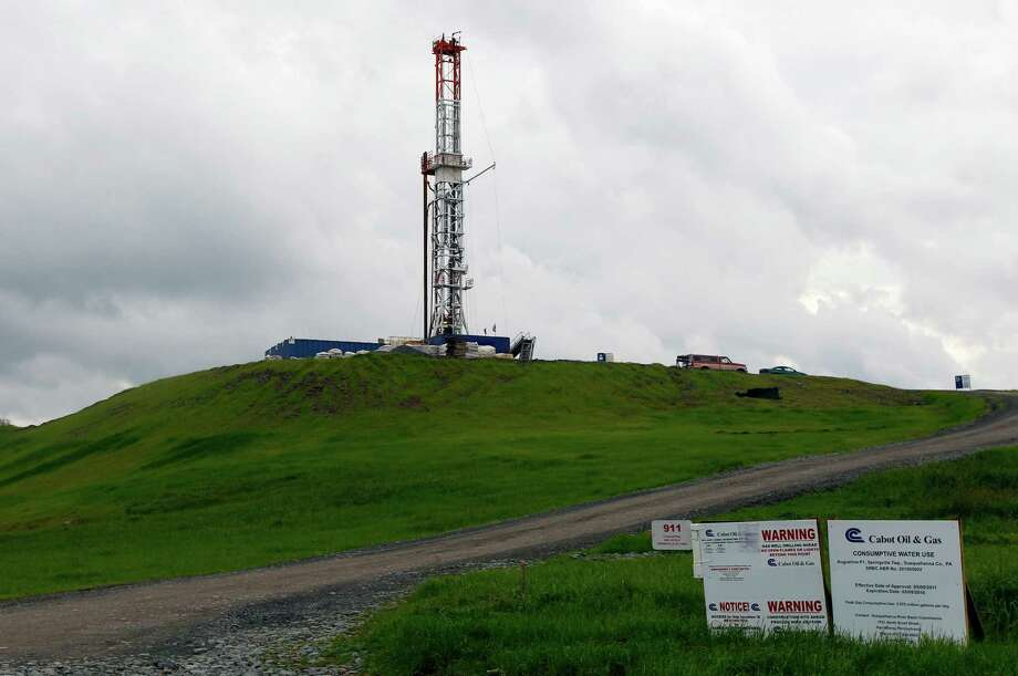 A drilling rig is seen Friday, Oct. 14, 2011 in Springville, Pa. State regulators blame faulty gas wells drilled for leaking methane into the groundwater in nearby Dimock, Pa. It was the first serious case of methane migration related to the Pennsylvania 3-year-old drilling boom, raising fears of potential environmental harm throughout the giant Marcellus Shale gas field. (AP Photo/Alex Brandon) Photo: Alex Brandon / AP