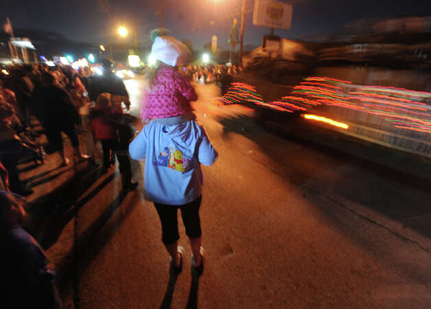 Revelers parade by at the Nederland Lighted Christmas Parade on Tuesday. Photo taken Tuesday, December 11, 2012 Guiseppe Barranco/The Enterprise Photo: Guiseppe Barranco, STAFF PHOTOGRAPHER / The Beaumont Enterprise