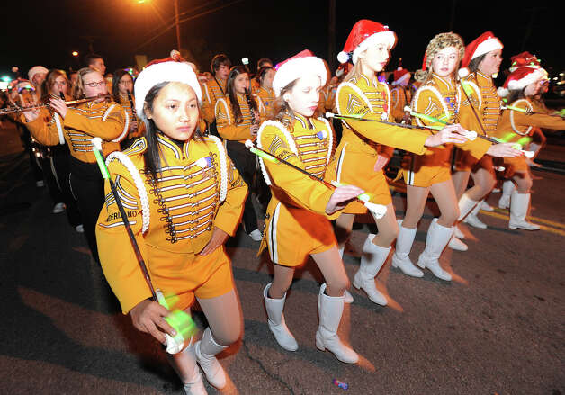 Nederland High School students parade by at the Nederland Lighted Christmas Parade on Tuesday. Waiting crowds watched as several floats lit up Nederland Avenue.  Photo taken Tuesday, December 11, 2012 Guiseppe Barranco/The Enterprise Photo: Guiseppe Barranco, STAFF PHOTOGRAPHER / The Beaumont Enterprise