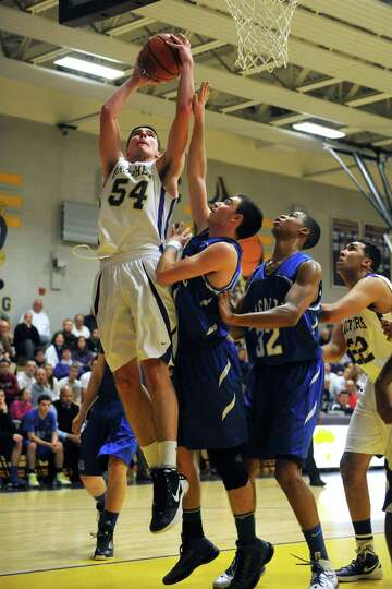 CBA's Greig Stire goes to the basket during their boy's high school basketball game against LaSalle