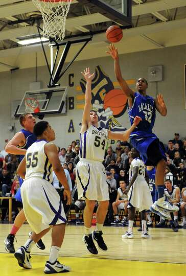 La Salle's Elijah Burns goes to the basket during their boy's high school basketball game against CB