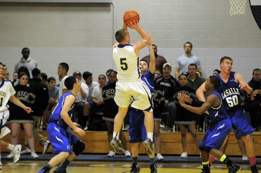 CBA's Nick Marini takes a shot during their boy's high school basketball game against LaSalle Coloni