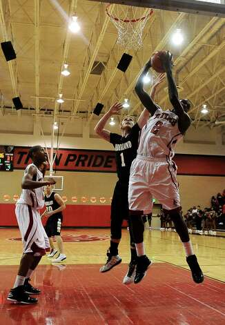 Memorial post Dorian Chatman, #2, gets the rebound during the Memorial High School basketball game against the Nederland High School on Tuesday December 11, 2012, at Memorial High School. Nederland won over Memorial 42- 41. Photo taken: Randy Edwards/The Enterprise
