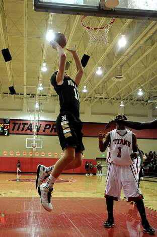 Nederland guard Zach English, #1, puts it up for two during the Memorial High School basketball game against the Nederland High School on Tuesday December 11, 2012, at Memorial High School. Nederland won over Memorial 42- 41. Photo taken: Randy Edwards/The Enterprise
