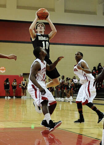 Nederland guard Zach English, #10 puts it up for two during the Memorial High School basketball game against the Nederland High School on Tuesday December 11, 2012, at Memorial High School. Nederland won over Memorial 42- 41. Photo taken: Randy Edwards/The Enterprise