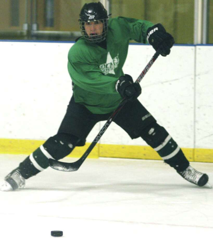Lorenzo Stellato of the Green Wave delivers a perfect lead pass for a teammate during New Milford High School ice hockey practice. December 2012 Photo: Norm Cummings