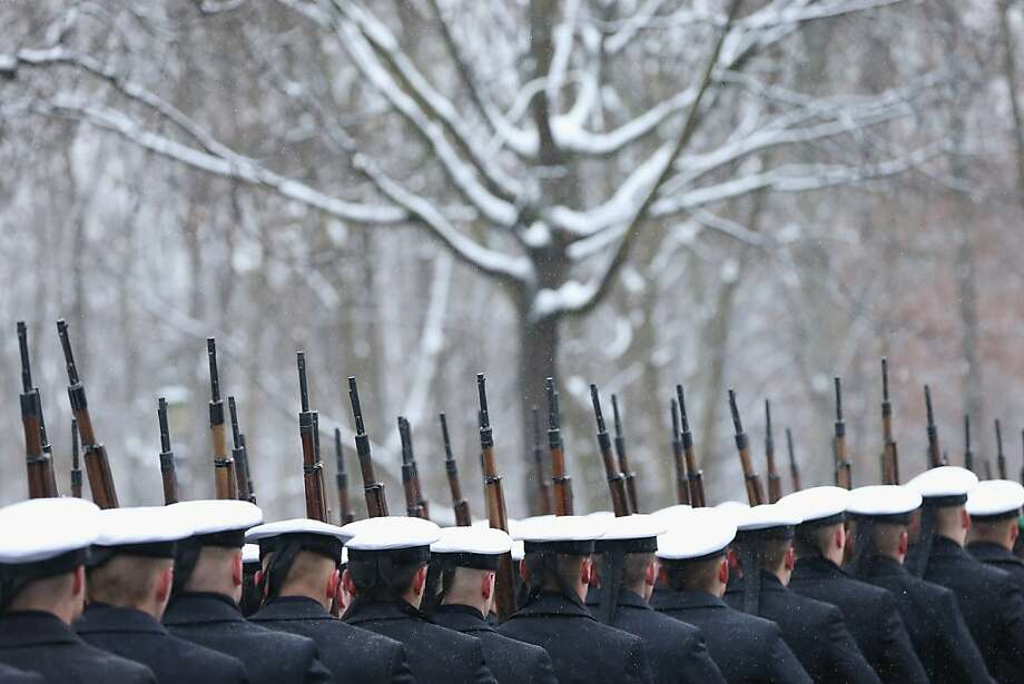 A guard of honour passes by snow-covoured trees after the arrival of Kyrgyz President Almaz Atambayev at Schloss Bellevue presidential palace on December 11, 2012 in Berlin, Germany. Much of northern Europe has been hit by heavy snowfalls in the past several days. Photo: Sean Gallup, Getty Images