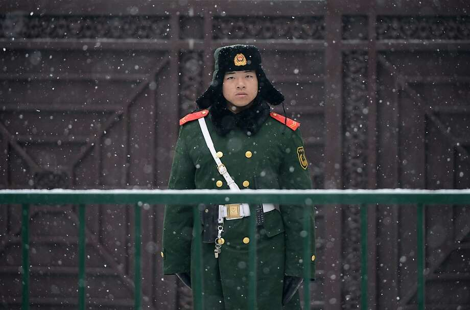 A Chinese paramilitary officer stands guard in the snow outside the North Korean Embassy in Beijing on December 12, 2012.  North Korea successfully launched a long-range rocket on December 12, in defiance of UN sanctions threats over what Pyongyang's critics have condemned as a disguised ballistic missile test. North Korea said the three-stage rocket, which Pyongyang insists was solely aimed at placing a satellite in orbit, had achieved all its objectives. Photo: Mark Ralston, AFP/Getty Images