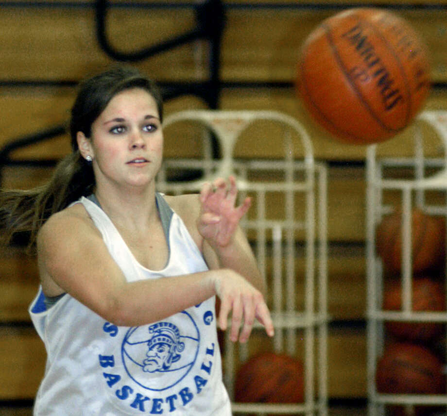 The Spartans' Bridget McCarthy delivers a pass during pre-season practice for Shepaug Valley High School girls' basketball. December 2012 Photo: Norm Cummings