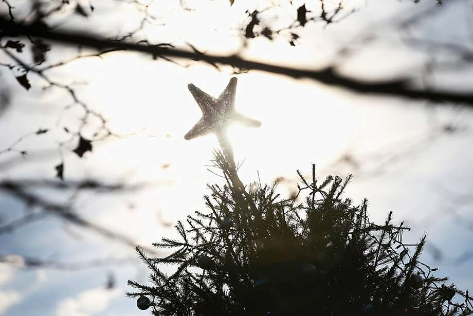 "A star sits perched on a Christmas ""tree of hope"" near the Midland Beach Veterans Memorial on December 11, 2012 on the Staten Island neighborhood of New York City. The tree was set up last weekend by neighbors in the area, which was devestated by Hurricane Sandy more than a month before. Photo: John Moore, Getty Images"