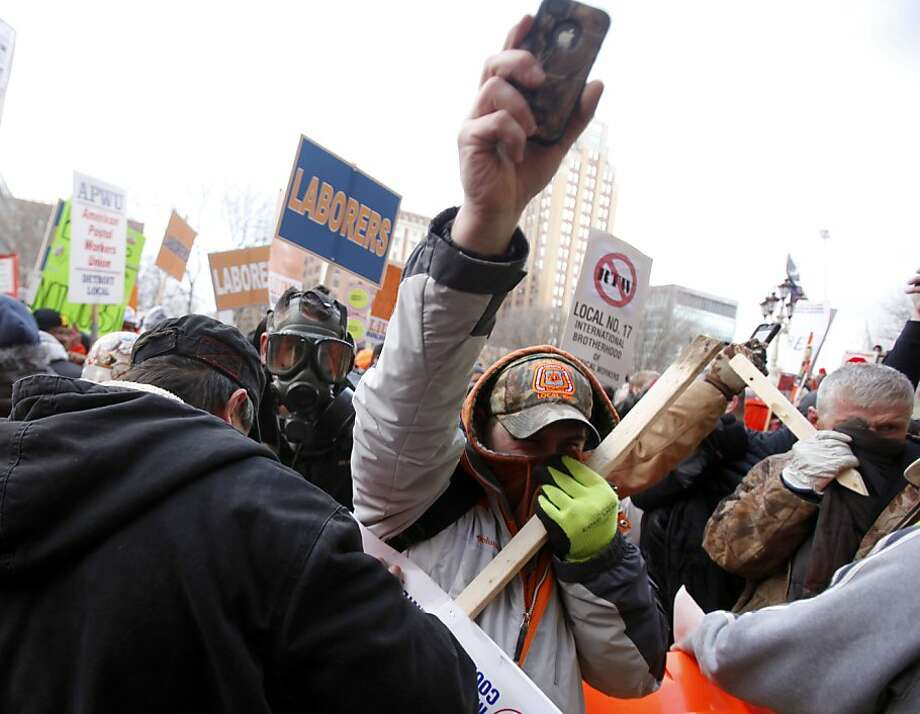 Protesting intensifies, as pepper spray is believed to be used by Michigan State Police to control the crowd as the protest against right-to-work legislation continues outside the Capitol in Lansing, Michigan, Tuesday, December 11, 2012. (Andre J. Jackson/Detroit Free Press/MCT) Photo: Andre J. Jackson, McClatchy-Tribune News Service