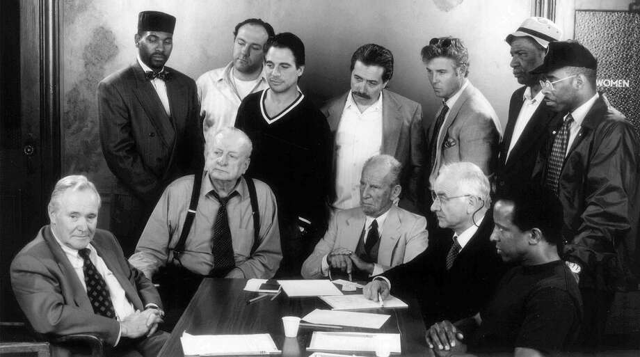 "Three times the ""Angry Men."" Reginald Rose's powerful 1954 teleplay ""Twelve Angry Men"" was also rewritten for the stage in 1955 with the same name and then as the 1957 movie ""12 Angry Men"" starring Henry Fonda. Photo: Jack Lemmon (far left), the lone juror among 12 who holds out for innocence in a capital murder case, stars in a television revival of ""Twelve Angry Men."" Standing from left to right are Mykelti Williamson, James Gandolfini, Tony Danza, Edward James Olmos, William Peterson, Ossie Davis and Courtney B. Vance. Seated from left to right are Lemmon, George C. Scott, Hume Cronyn, Armin Mueller-Stahl and Dorian Harewood. Photo: Kelvin Jones, Showtime"