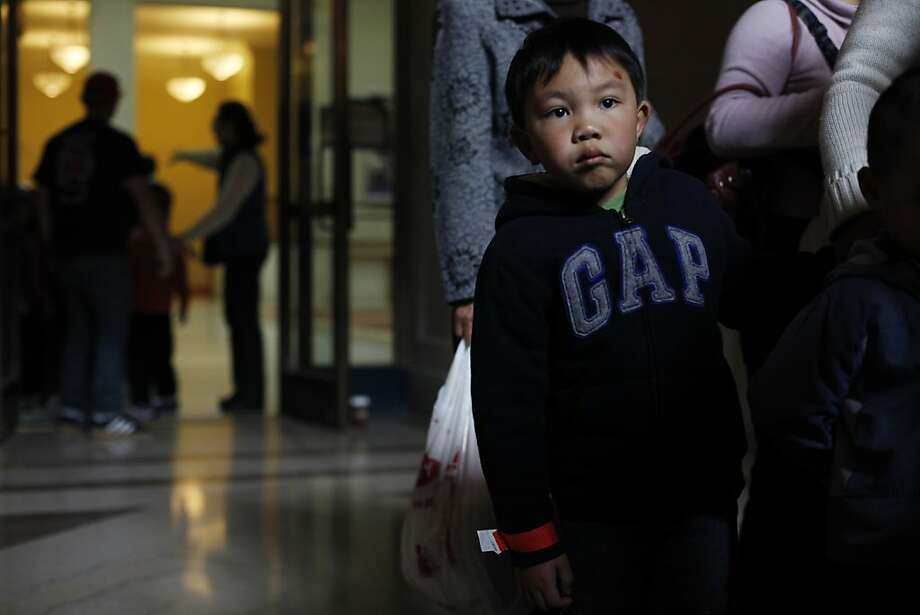 Thanks to efforts of the San Francisco Firefighters Toy Program and the San Francisco Dept. of Child Support Services, Eric Zeng, 5, joins roughly 1200 kids who received toys at City Hall on Tuesday Dec. 11, 2012 in San Francisco, Calif.