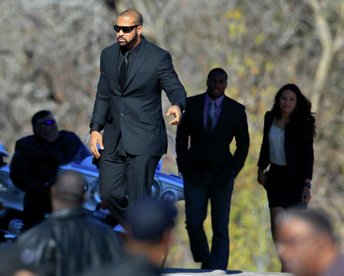 Dallas Cowboys' Jason Hatcher, center, and others arrive at a memorial service for practice squad member Jerry Brown at Oak Cliff Bible Fellowship Tuesday, Dec. 11, 2012, in Dallas. (AP Photo/LM Otero)