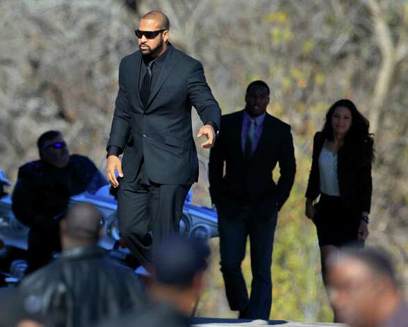 Dallas Cowboys' Jason Hatcher, center, and others arrive at a memorial service for practice squad member Jerry Brown at Oak Cliff Bible Fellowship Tuesday, Dec. 11, 2012, in Dallas. (AP Photo/LM Otero) Photo: LM Otero, Associated Press / AP